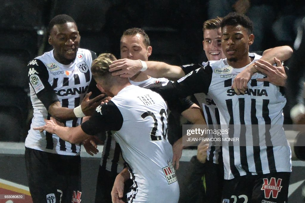 Angers' French midfielder Flavien Tait (C) is congratulated after scoring during the French L1 Football match between Angers (SCO) and Caen (SMC), on March 17, 2018, in Raymond-Kopa Stadium, in Angers, northwestern France. MONIER