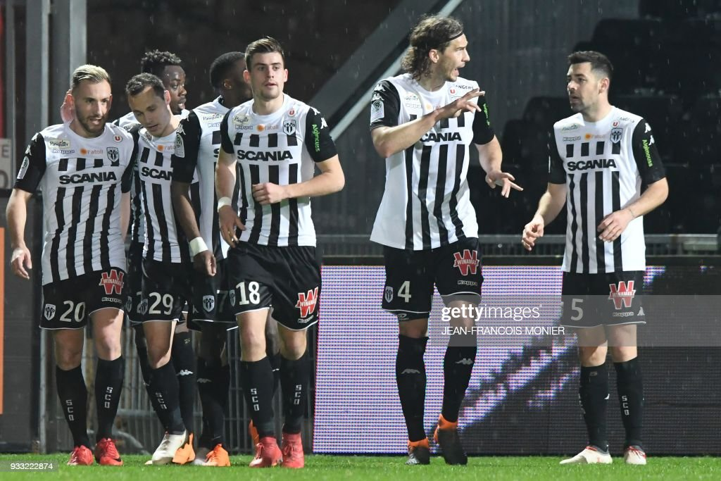 Angers' French midfielder Flavien Tait (R) is congratulated by his teammates after scoring during the French L1 Football match between Angers (SCO) and Caen (SMC), on March 17, 2018, in Raymond-Kopa Stadium, in Angers, northwestern France. PHOTO / Jean-Francois MONIER