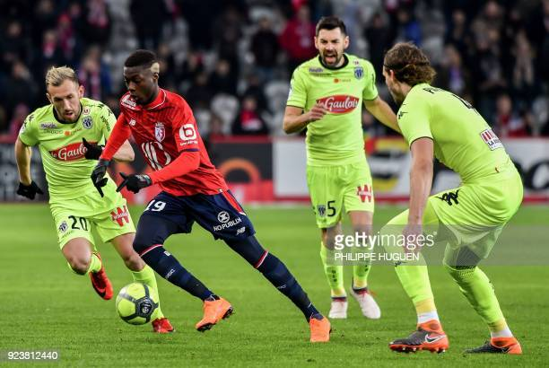 Angers' French midfielder Flavien Tait vies with Lille's Ivorian forward Nicolas Pepe during the French L1 football match Lille vs Angers on February...