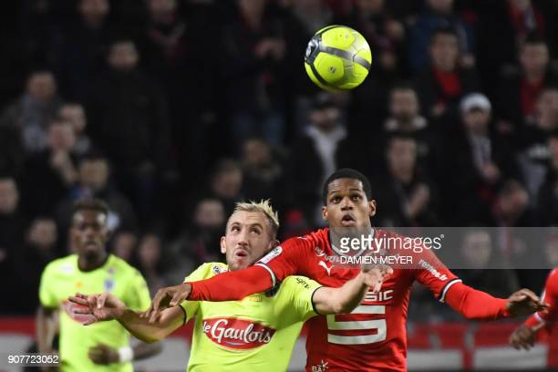 Angers' French midfielder Flavien Tait vies with Rennes' French defender Ludovic Baal during the French L1 football match between Rennes and Angers...