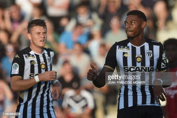 Angers' French midfielder Jeff Reine Adelaide celebrates after scoring a goal during the French L1 football match between SCO Angers and FC Girondins...