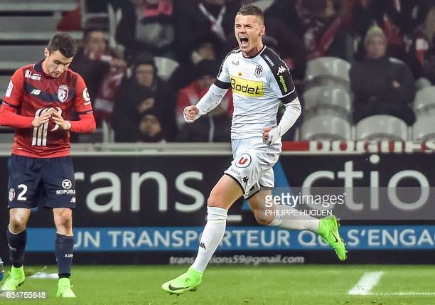Angers' French midfielder Pierrick Capelle celebrates after scoring a goal during the French L1 football match between Lille and Anger on Februrary...