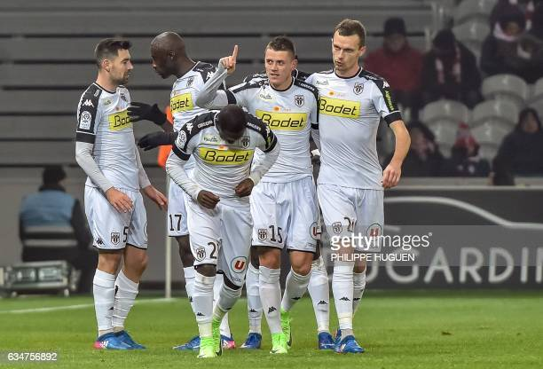 Angers' French midfielder Pierrick Capelle celebrates with his teammates after scoring a goal during the French L1 football match between Lille and...