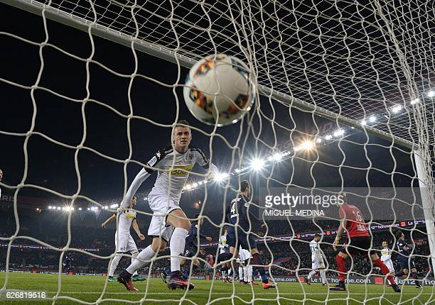 Angers' French midfielder Pierrick Capelle eyes the ball after Paris SaintGermain's Brazilian defender Thiago Silva scored a header during the French...