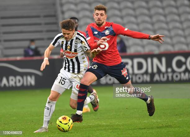 Angers' French midfielder Pierrick Capelle is challenged by Lille's Portuguese midfielder Xeka during the French L1 football match LOSC Lille and...