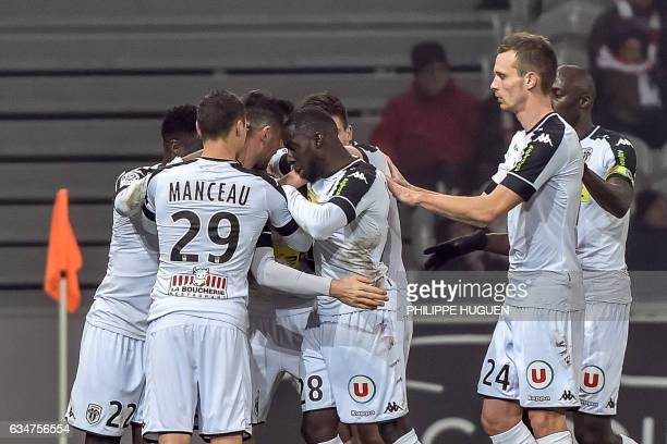 Angers' French midfielder Pierrick Capelle is congratuled by his teammate after scoring a goal during the French L1 football match between Lille and...