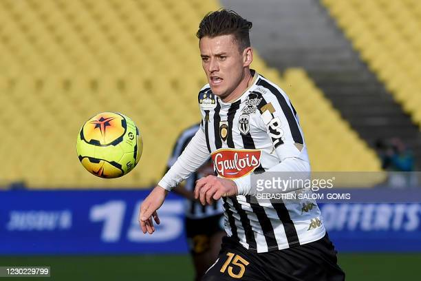 Angers' French midfielder Pierrick Capelle runs with the ball during the French L1 football match between FC Nantes and Angers SCO at La Beaujoire...