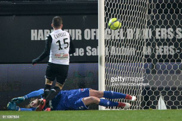 Angers' French midfielder Pierrick Capelle scores over Amiens' French goalkeeper Regis Gurtner during the French L1 Football match between Angers and...