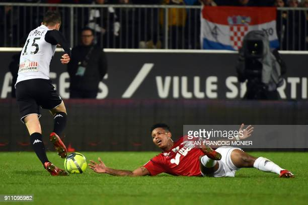 Angers' French midfielder Pierrick Capelle vies with Amien's SouthAfrican midfielder Bongani Zungu during the French L1 football match between Angers...
