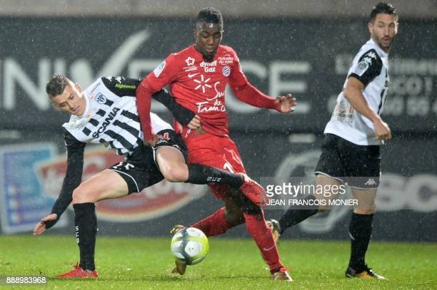 Angers' French midfielder Pierrick Capelle vies with Montpellier's French forward Isaac Mbenza during the French L1 Football match between Angers and...