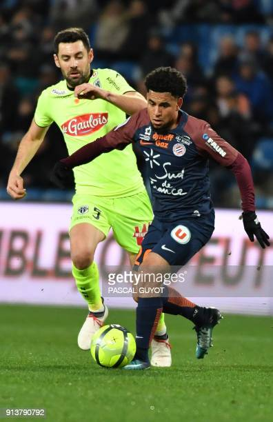 Angers' French midfielder Thomas Mangani vies with Montpellier's South African forward Keagan Dolly during the French L1 football match between MHSC...