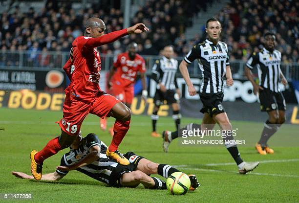Angers' French midfielder Vincent Manceau vies for the ball with Montpellier's Senegalese forward Souleymane Camara during the French L1 football...
