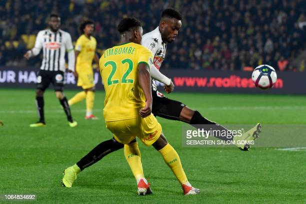 Angers' Ivorian defender Abdoulaye Bamba vies for the ball with Nantes' Belgian midfielder Anthony Limbombe during the French Ligue 1 football match...
