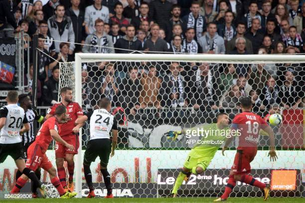 Angers' Ivorian defender Ismael Traore scores a goal next to Lyon's FrenchPortuguese defender Anthony Lopes during the French L1 football match...