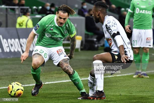 Angers' Ivorian defender Souleyman Doumbia fights for the ball Saint-Etienne's Gabonese forward Denis Bouanga during the French L1 football match...