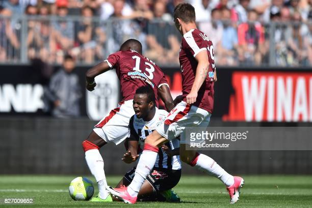 Angers' Malian midfielder Lassana Coulibaly vies for the ball with Bordeaux's Senegalese midfielder Younousse Sankhare and Bordeaux's Danish...