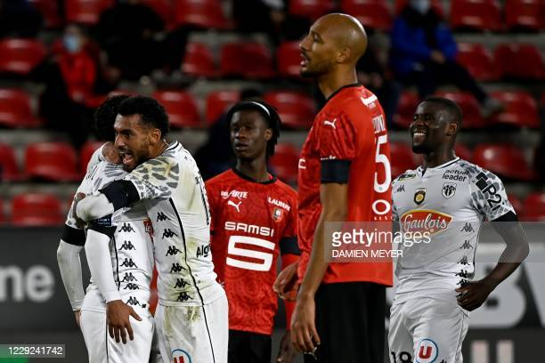 Angers' players celebrate after scoring a goal during the French L1 football match between Stade Rennais and Angers, at the Roazhon Park stadium in...