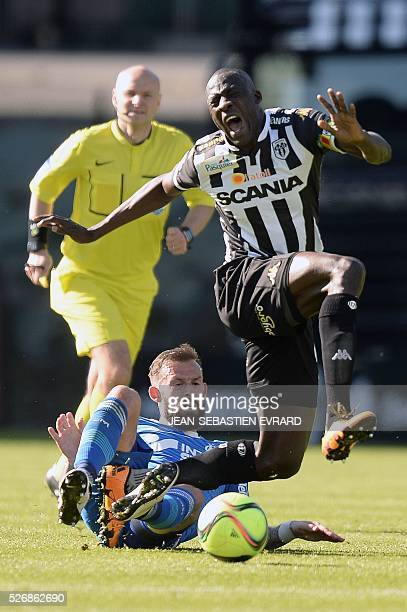 Angers' Senegalese midfielder Cheikh N'Doye is tackled by Marseille's Scottish forward Steven Fletcher during the French L1 football match between...