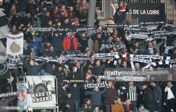 Angers' supporters hold team scarf during the French L1 Football match between Angers SCO and Lille , at the Raymond-Kopa Stadium, in Angers,...