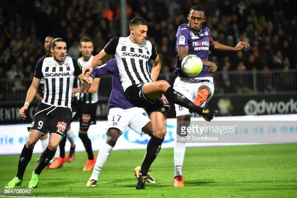 Angers's Algerian defender Mehdi Tahrat vies with Toulouse's French defender Issa Diop during the French L1 football match between Angers and...