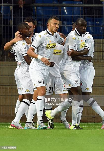 Angers's players react after scoring during the French L1 football match between Montpellier and Angers on august 08 2015 at the La Mosson Stadium in...