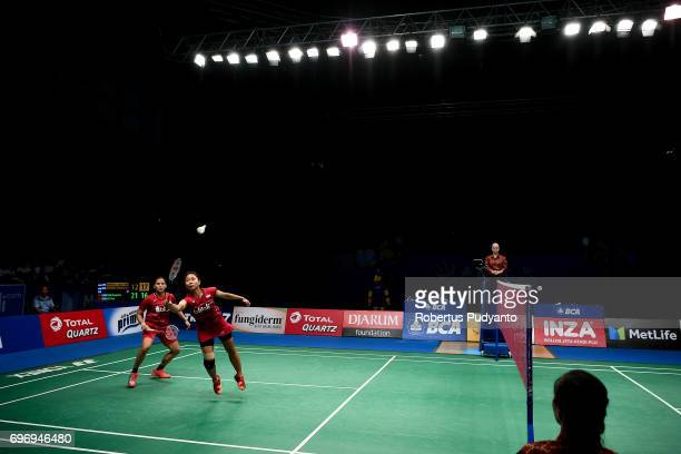 Anggia Shitta Awanda and Ni Ketut Mahadewi Istarani of Indonesia compete against Chen Qingchen and Jia Yifan of China during Womens Double Semifinal...