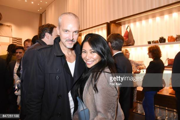 Anggun and her husband Olivier Maury attend the Loewe Cocktail As part of 'La Fete Des Vendanges' At Avenue Montaigne on September 14 2017 in Paris...