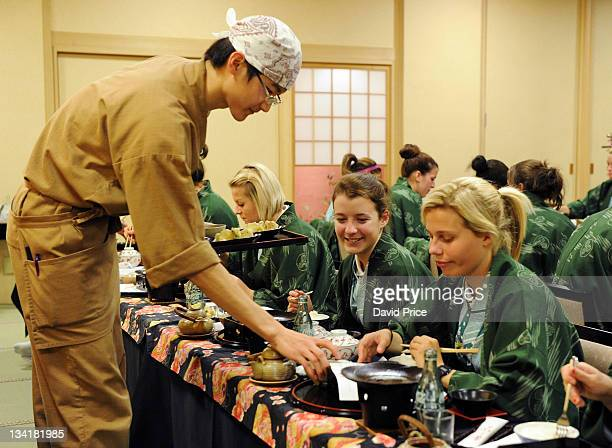 Angharad James and Gilly Flaherty of Arsenal Ladies FC players eat a traditional Japanese Meal in their hotel in Kyoto during their tour to Japan on...