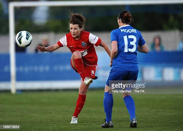 Angharad James of Bristol Acadamy passes the ball past Jade Moore of Birmingham City during The FA Women's Super League match between Birmingham City...
