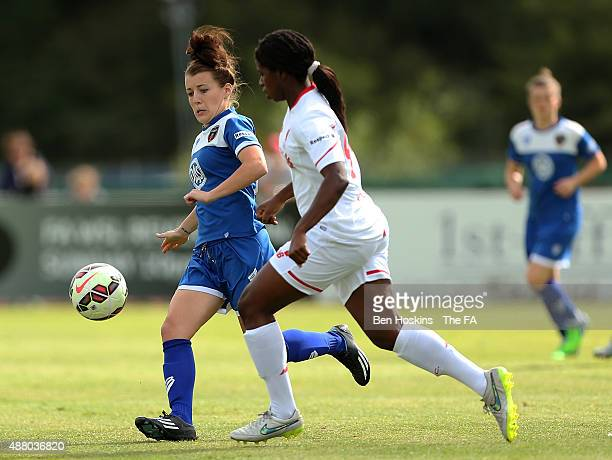 Angharad James of Bristol battles for posession with Satara Murray of Liverpool during FA WSL Continental Tyres Cup Quarter Final match between...