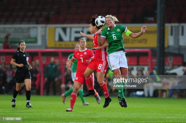 Angharad James of Wales battles with Ashley Hutton of Northern Ireland during the UEFA Womens Euro Qualifier match between Wales and Northern Ireland...
