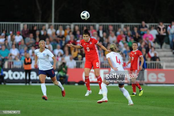 Angharad James of Wales Women vies for possession with Jordan Nobbs of England Women during the FIFA Women's World Cup Qualifier match between Wales...