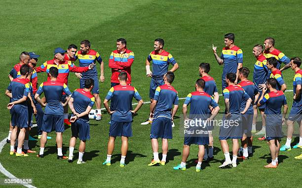 Anghel Iordanescu manager of Romania and players are seen during training session ahead of the UEFA EURO 2016 Group A match between France and...