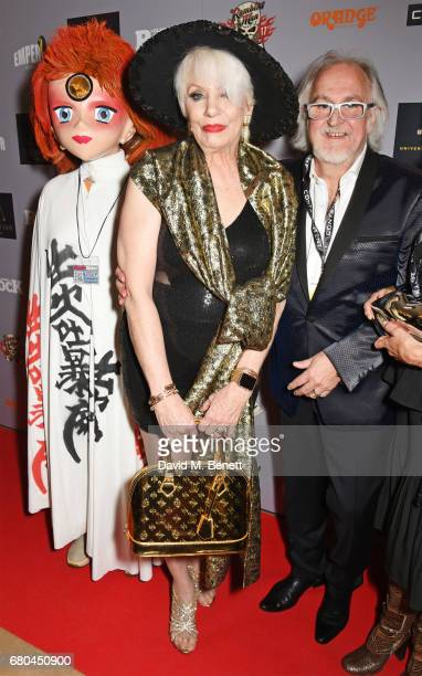 Angie Bowie and director Jon Brewer attend a VIP screening of Beside Bowie The Mick Ronson Story at The May Fair Hotel on May 8 2017 in London England