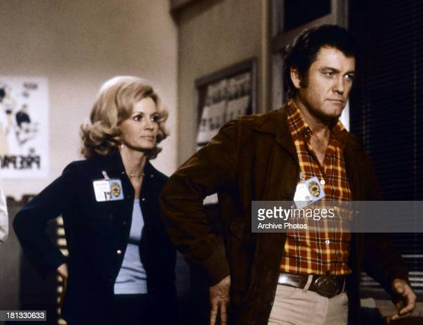 Angie Dickinson and Earl Holliman in a scene from the TV series 'Police Woman' circa 1975