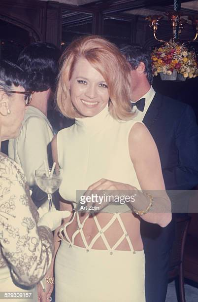Angie Dickinson at a formal event wearing a white bare midriff dress circa 1970 New York