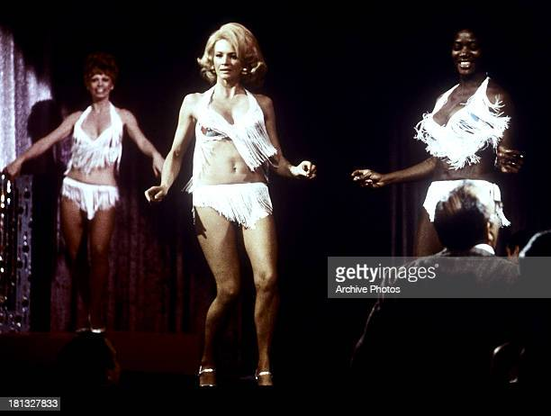 Angie Dickinson dances in a scene from the TV series 'Police Woman' circa 1975