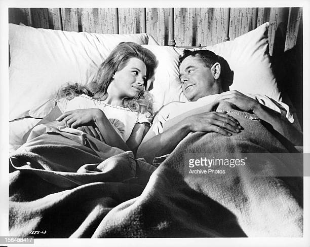 Angie Dickinson in bed with Glenn Ford in a scene from the film 'The Last Challenge' 1967