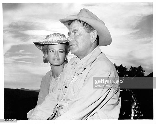 Angie Dickinson rides with Chad Everett in a scene from the film 'The Last Challenge' 1967