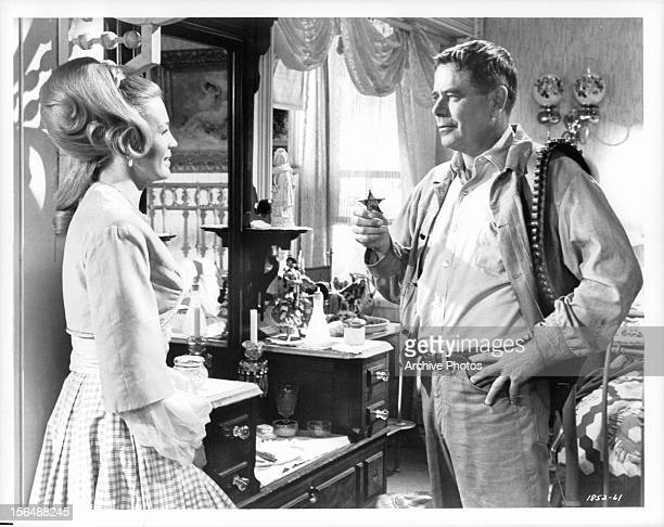 Angie Dickinson talking with Glenn Ford in a scene from the film 'The Last Challenge' 1967