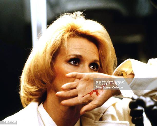 Angie Dickinson US actress has her hand slashed by a cutthroat razor in a publicity still issued for the film 'Dressed to Kill' 1980 The thriller...