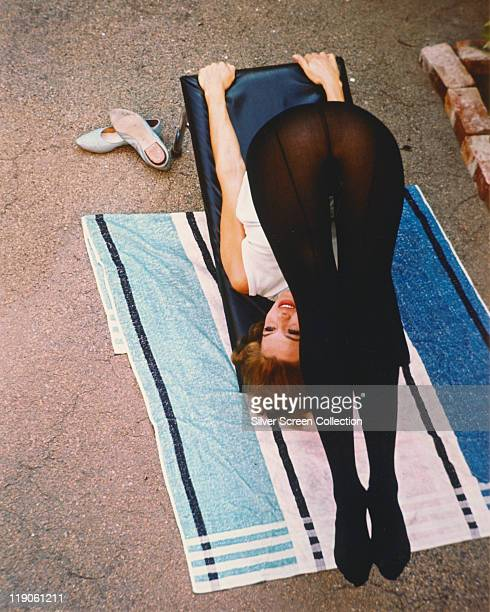 Angie Dickinson US actress holding a yoga pose circa 1970