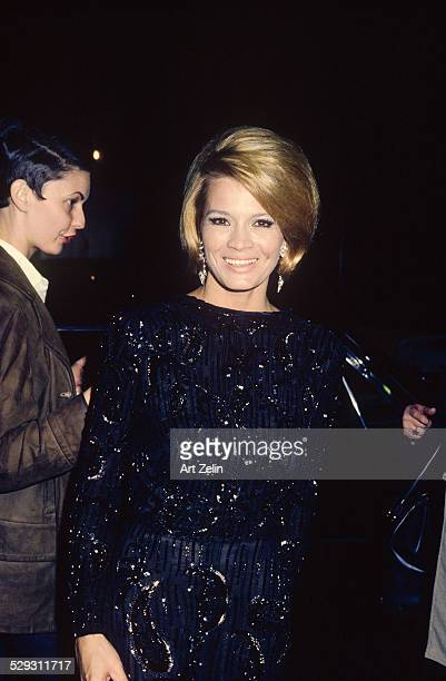Angie Dickinson wearing a black beaded formal circa 1970 New York