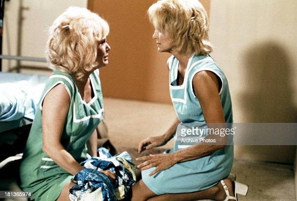 Angie Dickinson with another woman in a scene from the TV series 'Police Woman' circa 1975