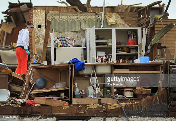 Angie Elbert helps look for items to salvage from her grandmother's house after it was destroyed when a massive tornado passed through the town...