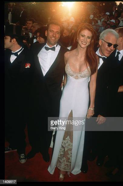 Angie Everhardt attends the 69th Annual Academy Awards ceremony March 24 1997 in Los Angeles CA