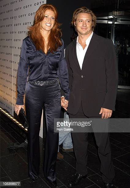 Angie Everhart and Guest during Coty's 100th Anniversary Celebration September 12 2004 at American Museum of Natural History's Rose Center in New...