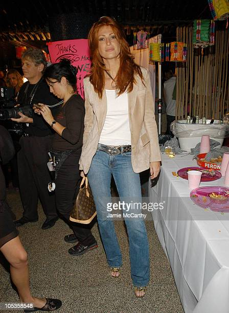 Angie Everhart during Olympus Fashion Week Spring 2005 Betsey Johnson Backstage at The Ballroom Maritime Hotel in New York City New York United States
