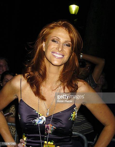 Angie Everhart during Olympus Fashion Week Spring 2006 Fashion For Relief Inside at The Tents at Olympus Fashion Week in New York New York United...