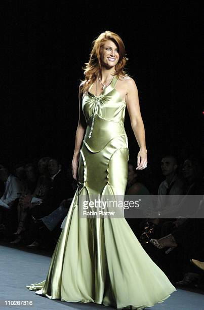 Angie Everhart during Olympus Fashion Week Spring 2006 Fashion For Relief Runway at The Tents at Olympus Fashion Week in New York New York United...